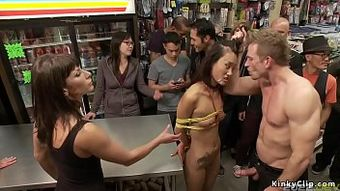 Petite Asian is bound and public fucked
