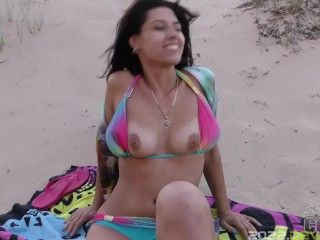 office girl caroline masturbating on the beach on extremely windy day