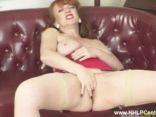 Busty redhead finger fucks wet pussy in retro look nylons girdle and heels