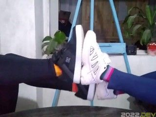 Two Girls Comparing SHOES ans SOCKS