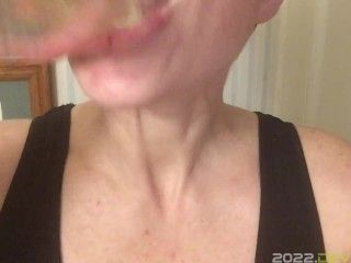 Myra swallows a fresh glass of her squirt. 4K