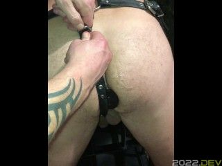 Butt plugged, restrained, seated and sucked off.