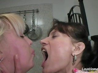 Sexy dike hotties are licking each other passionately